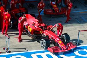 The Sebastian Vettel Ferrari SF1000 in the pit lane