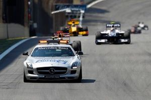 The Safety Car leads Sebastian Vettel, Red Bull Racing RB6 Renault, Nico Hulkenberg, Williams FW32 Cosworth, Robert Kubica, Renault R30