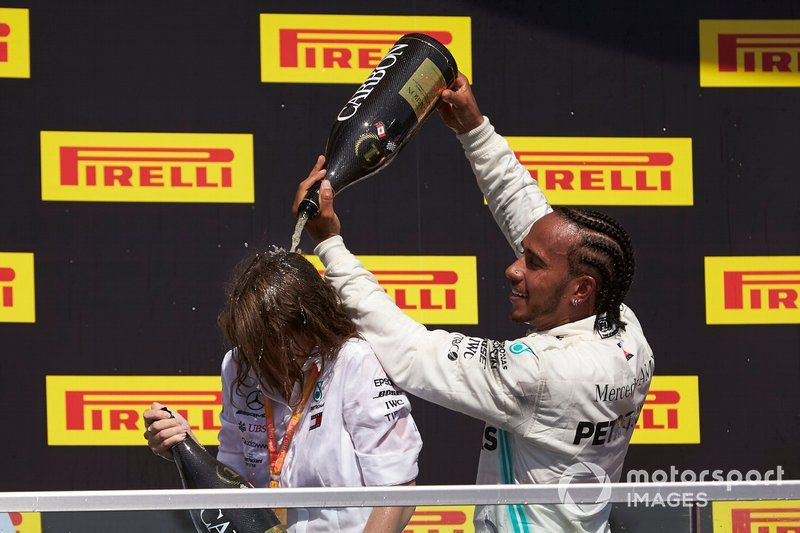 Lewis Hamilton, Mercedes AMG F1, 1st position, pours Champagne on his team mate on the podium