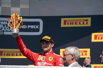 Charles Leclerc, Ferrari, 3rd position, lifts his trophy