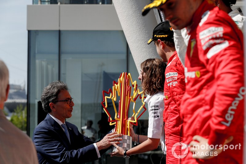 The Constructors trophy is presented on the podium