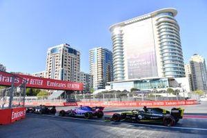 Kevin Magnussen, Haas F1 Team VF-19, leads Sergio Perez, Racing Point RP19, and Daniel Ricciardo, Renault R.S.19
