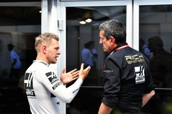 Kevin Magnussen, Haas F1, talks with Guenther Steiner, Team Principal, Haas F1