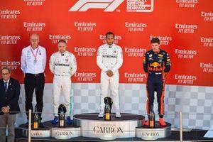 Dr Dieter Zetsche, CEO, Mercedes Benz,Valtteri Bottas, Mercedes AMG F1, 2nd position, Lewis Hamilton, Mercedes AMG F1, 1st position, and Max Verstappen, Red Bull Racing, 3rd position, on the podium