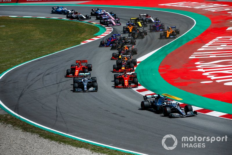 Lewis Hamilton, Mercedes AMG F1 W10 leads, Valtteri Bottas, Mercedes AMG W10, Sebastian Vettel, Ferrari SF90 and Charles Leclerc, Ferrari SF90 at the start of the race