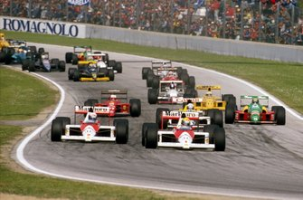 Ayrton Senna leads teammate Alain Prost, McLaren MP4/5 at the start