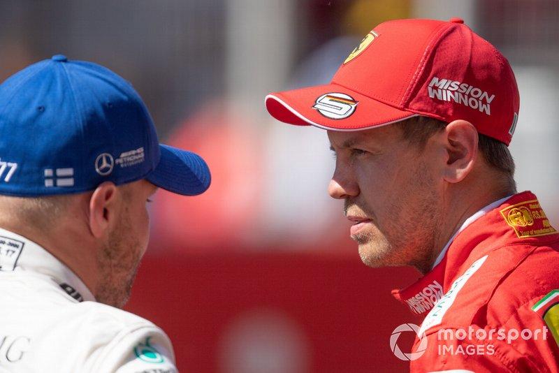 Le poleman Valtteri Bottas, Mercedes AMG F1, avec Sebastian Vettel, Ferrari