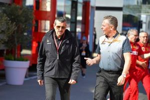 Guenther Steiner, Team Principal, Haas F1, and Mario Isola, Racing Manager, Pirelli Motorsport