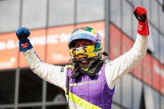Beitske Visser celebrates in Parc Ferme after winning the race