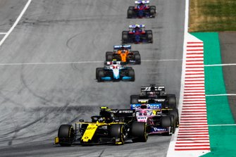 Nico Hulkenberg, Renault F1 Team R.S. 19, leads Lance Stroll, Racing Point RP19, Daniel Ricciardo, Renault F1 Team R.S.19, and Romain Grosjean, Haas F1 Team VF-19