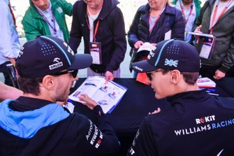 Robert Kubica, Williams Racing and George Russell, Williams Racing sign autographs for fans