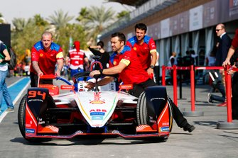 The Mahindra Racing team push the car of Felix Rosenqvist in the pits
