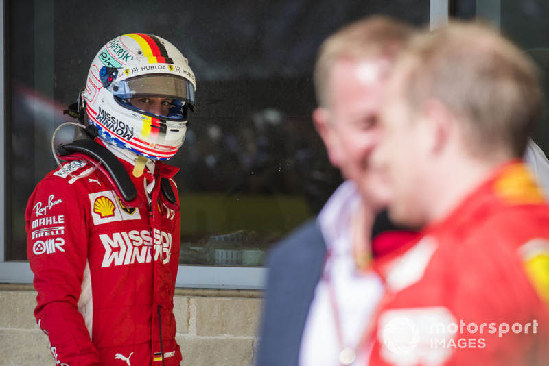 Sebastian Vettel, Ferrari, looks over as Kimi Raikkonen, Ferrari, 1st position, is interviewed by Martin Brundle, Sky Sports F1.