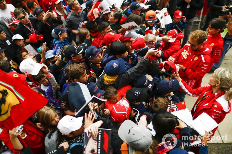 Sebastian Vettel, Ferrari, signs autographs for fans