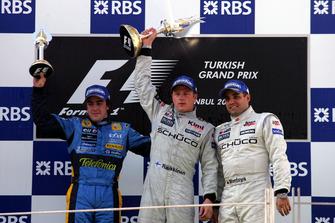 Podium: second place Fernando Alonso, Renault F1 Team, Race winner Kimi Raikkonen, McLaren, third place Juan Pablo Montoya, McLaren