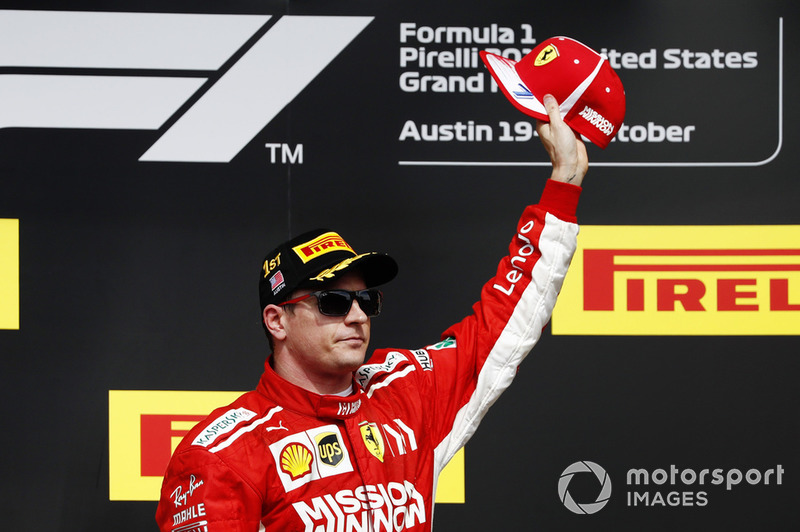 Kimi Raikkonen, Ferrari, celebrates on the podium after winning the race