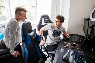 Lando Norris demonstrates his home simulator to Autosport journalist Jack Benyon