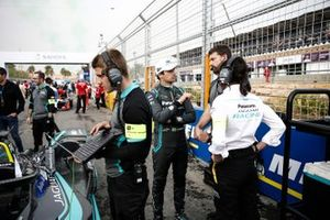 Nelson Piquet Jr., Panasonic Jaguar Racing chats with his engineer on the grid