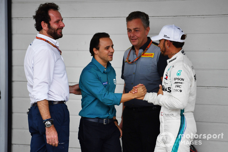 Pole sitter Lewis Hamilton, Mercedes AMG F1 celebrates with Felipe Massa, Matteo Bonciani, FIA Media Delegate and Mario Isola, Pirelli Sporting Director in Parc Ferme
