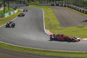 Kimi Raikkonen, Ferrari SF71H leads Romain Grosjean, Haas F1 Team VF-18