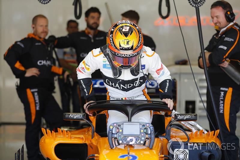 Stoffel Vandoorne, McLaren, lowers himself into his seat