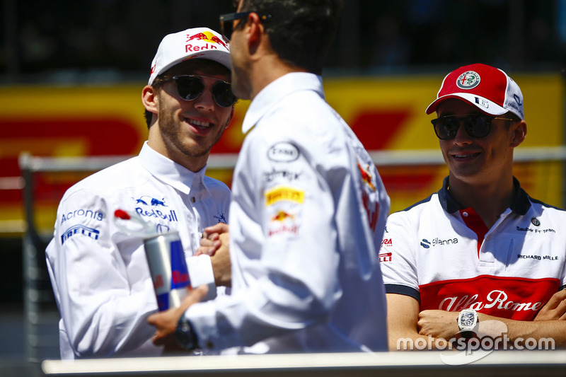 Pierre Gasly, Toro Rosso, Daniel Ricciardo, Red Bull Racing, and Charles Leclerc, Sauber, in the drivers parade