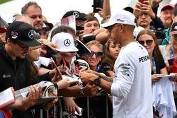 Lewis Hamilton, Mercedes-AMG F1 signs autographs for the fans