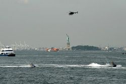 Jet Skis, a ferry in the Hudson River near the Statue of Liberty
