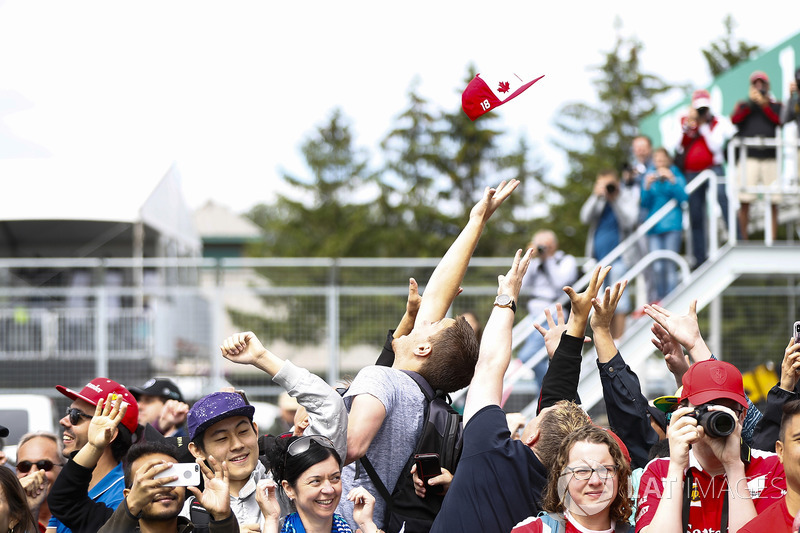 A cap is thrown towards an excited crowd