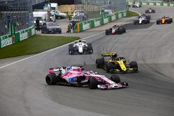 A sideways Sergio Perez, Force India VJM11, battles with Carlos Sainz Jr., Renault Sport F1 Team R.S. 18