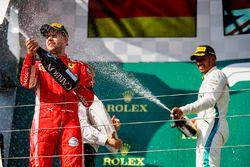 Sebastian Vettel, Ferrari celebrates by spraying champagne on the podium with Lewis Hamilton, Mercedes AMG F1
