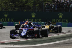 Brendon Hartley, Toro Rosso STR13, leads Nico Hulkenberg, Renault Sport F1 Team R.S. 18, and Fernando Alonso, McLaren MCL33