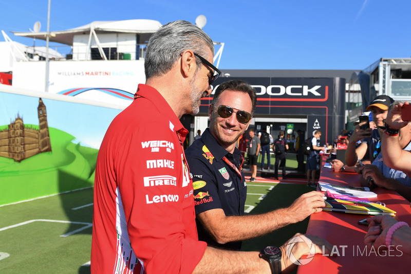 Christian Horner, Red Bull Racing Team Principal and Maurizio Arrivabene, Ferrari Team Principal with fans
