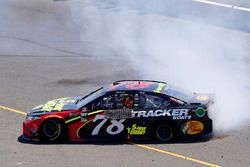 Martin Truex Jr., Furniture Row Racing, Toyota Camry 5-hour ENERGY/Bass Pro Shops celebrates his win with a burnout