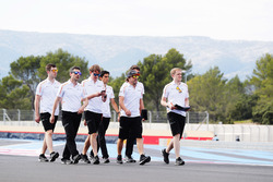 Fernando Alonso, McLaren, walks the track with his team