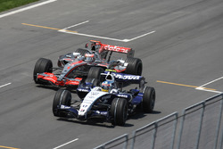 Fernando Alonso, McLaren MP4-22, attempts a pass on Alex Wurz, Williams FW29