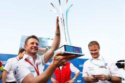 Allan McNish, Team Principal, Audi Sport Abt Schaeffler, celebrates with the trophy on the podium