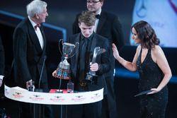 McLaren Autosport BRC Award winner Dan Ticktum on stage with John Fitzpatrick