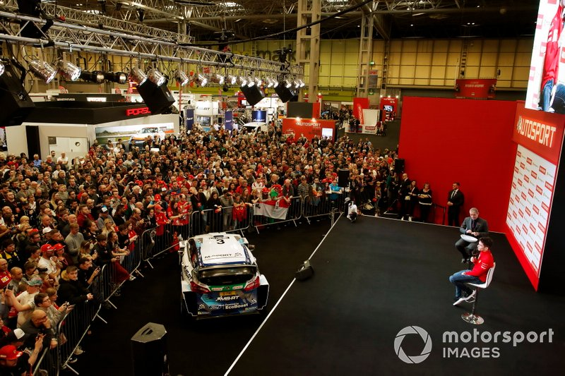 Presenter Stuart Codling interviews Charles Leclerc, Ferrari on the Autosport stage in front of a large crowd