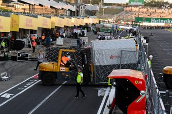 Containers are packed ready for shipping in the pit lane