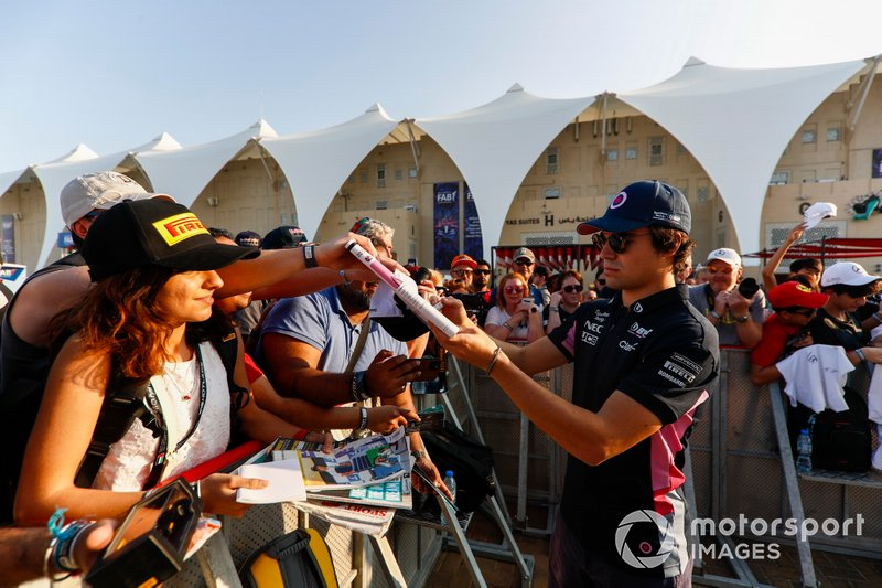 Lance Stroll, Racing Point, signs autographs for fans
