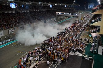 Max Verstappen, Red Bull Racing RB15 and Lewis Hamilton, Mercedes AMG F1 W10, perform donuts