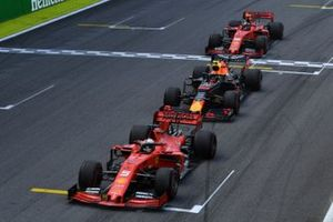 Sebastian Vettel, Ferrari SF90, leads Alexander Albon, Red Bull RB15, and Charles Leclerc, Ferrari SF90, at the end of the first Safety Car period