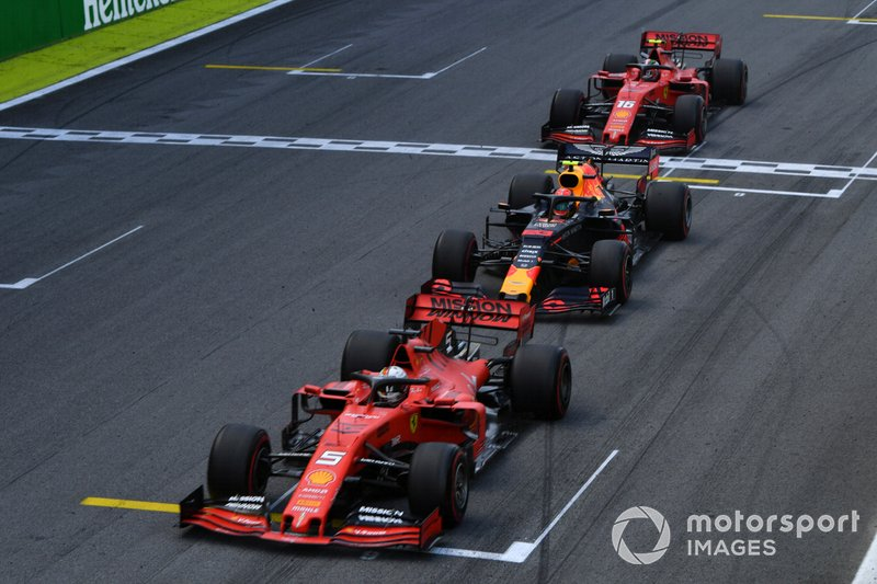 Sebastian Vettel, Ferrari SF90, leads Alexander Albon, Red Bull RB15, and Charles Leclerc, Ferrari SF90, at the end of the first Safety Car period