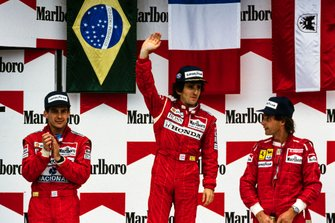 Podium: Race winner Allain Prost, second place Ayrton Senna, McLaren, third place Gerhard Berger, Ferrari