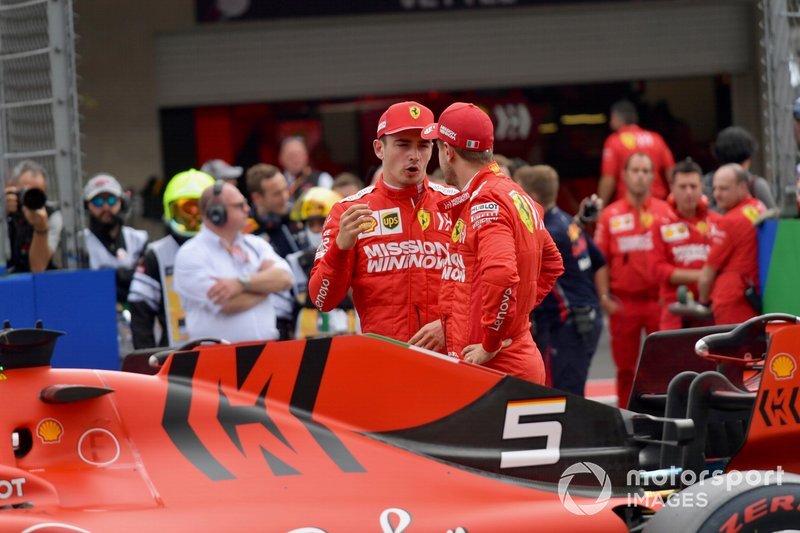 Charles Leclerc, Ferrari, and Sebastian Vettel, Ferrari, talk after Qualifying