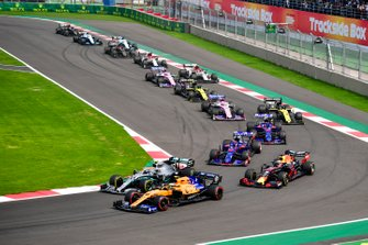 Lando Norris, McLaren MCL34, leads Valtteri Bottas, Mercedes AMG W10, Max Verstappen, Red Bull Racing RB15, Daniil Kvyat, Toro Rosso STR14, Pierre Gasly, Toro Rosso STR14, Daniel Ricciardo, Renault F1 Team R.S.19, and the remainder of the field at the start