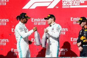 Lewis Hamilton, Mercedes AMG F1, and Valtteri Bottas, Mercedes AMG F1, celebrate on the podium with Max Verstappen, Red Bull Racing