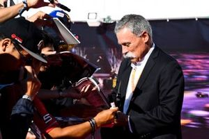 Chase Carey, Chairman, Formula 1 signs an autograph for a fan