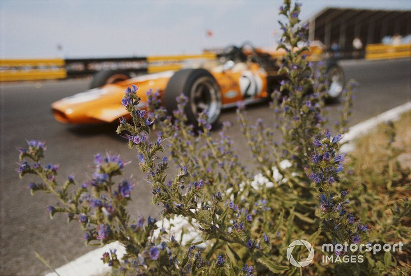 Andrea de Adamich, McLaren M14D Alfa Romeo, viewed through flowers
